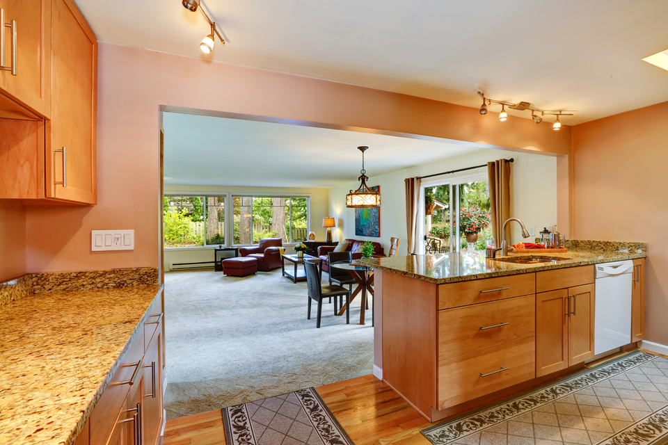 Bright kitchen room with light tone cabinets and rugs